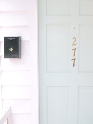 """After weeks of staring at paint samples, Mary Margaret chose XXXX for the front door. """"I realized that paint is so easy to change. We love it for now, and if we change our minds one day, it's such a simple fix."""""""